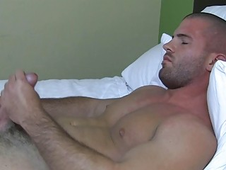 Sexy muscled gay stud plays all round his indestructible bazooka in bed